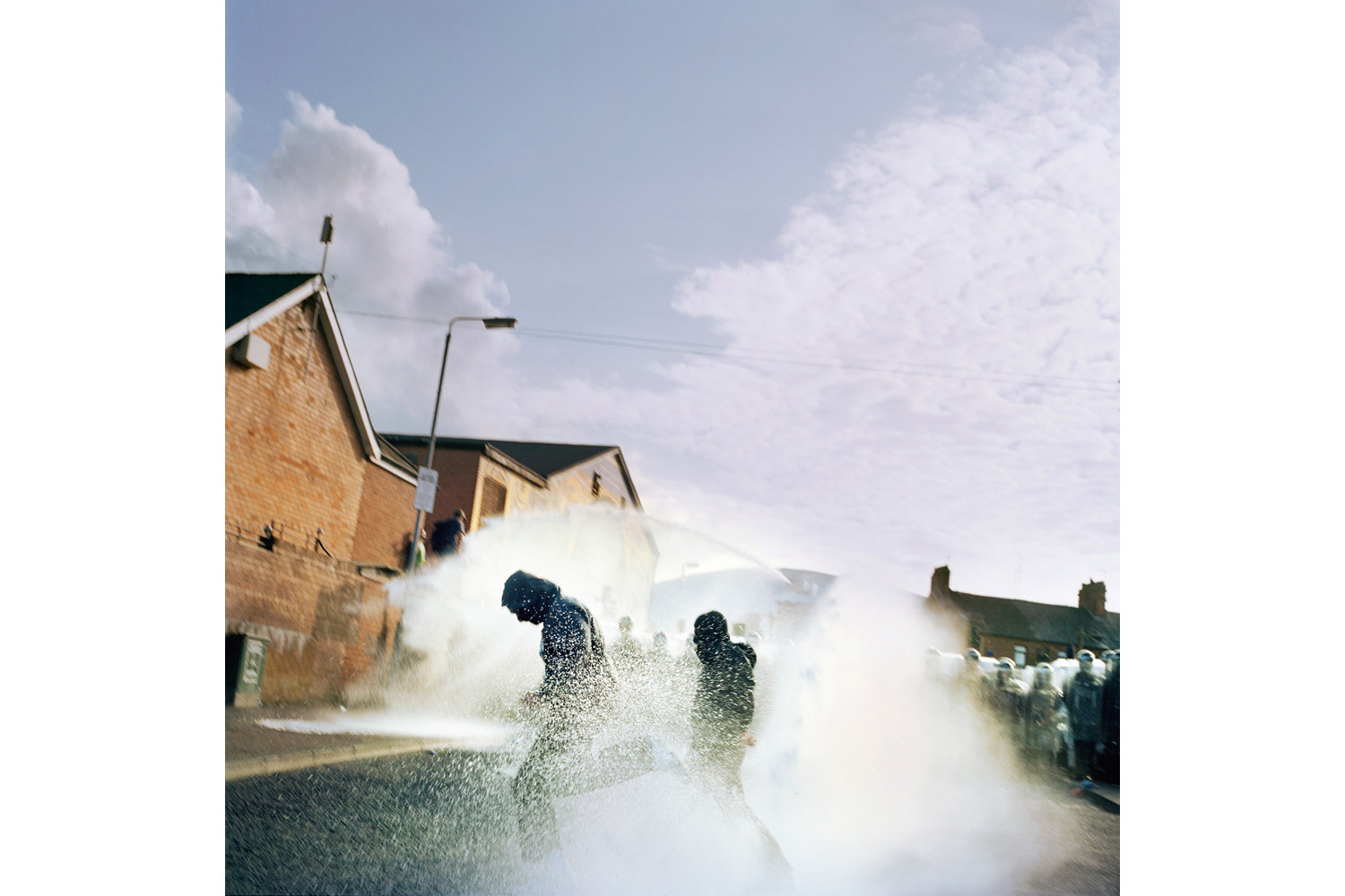Riot police use water canons to repel Republican (Catholic) youth as they attempt to disrupt a loyalist (Protestant) band marching past their estate during the annual July 12 parades. The annual marching season still brings trouble between Protestant and Catholic communities living in close proximity to each other. 2011.
