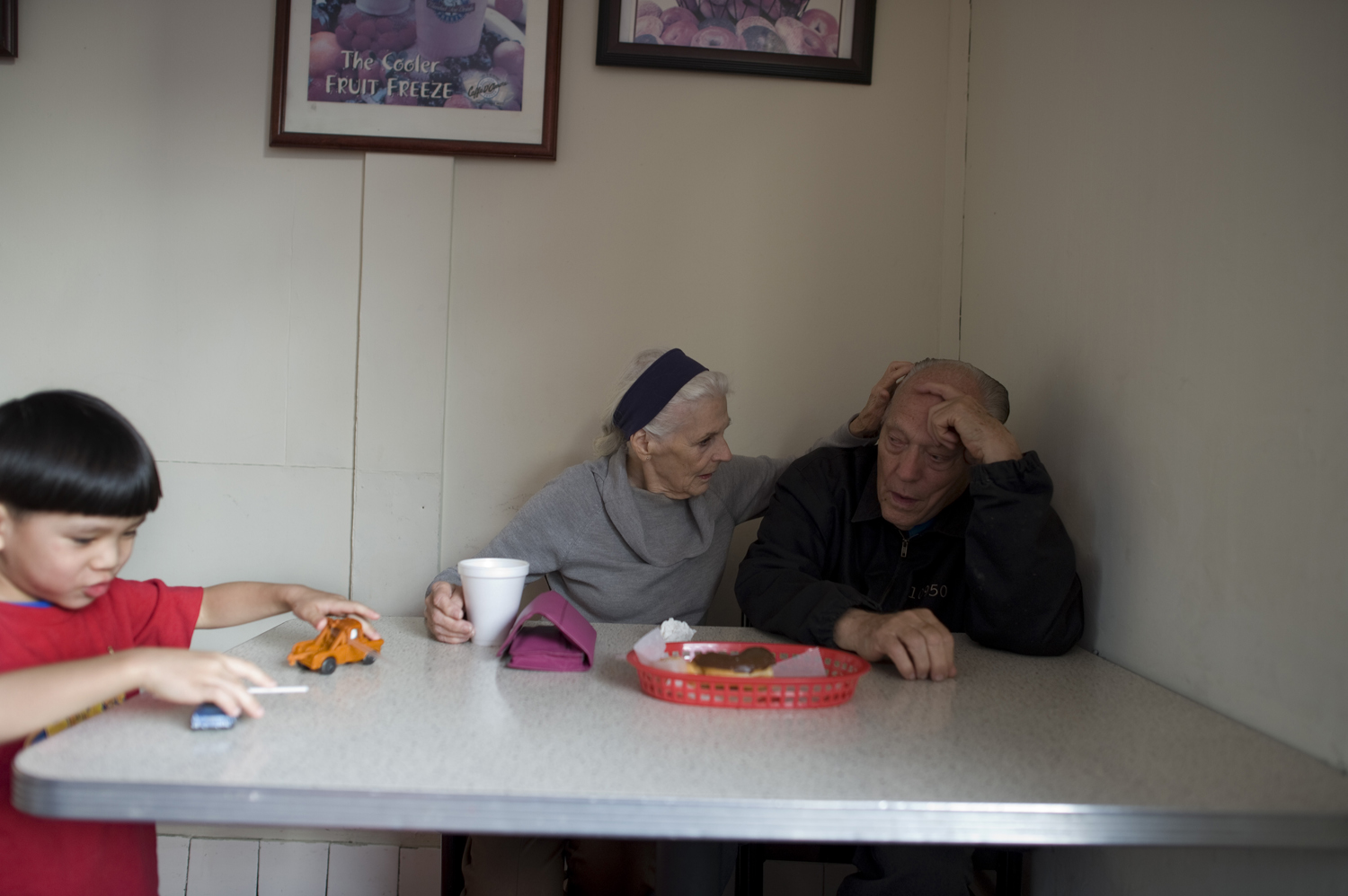 Jeanie consoles William as he watches the coffee shop owner's son play, 2011.