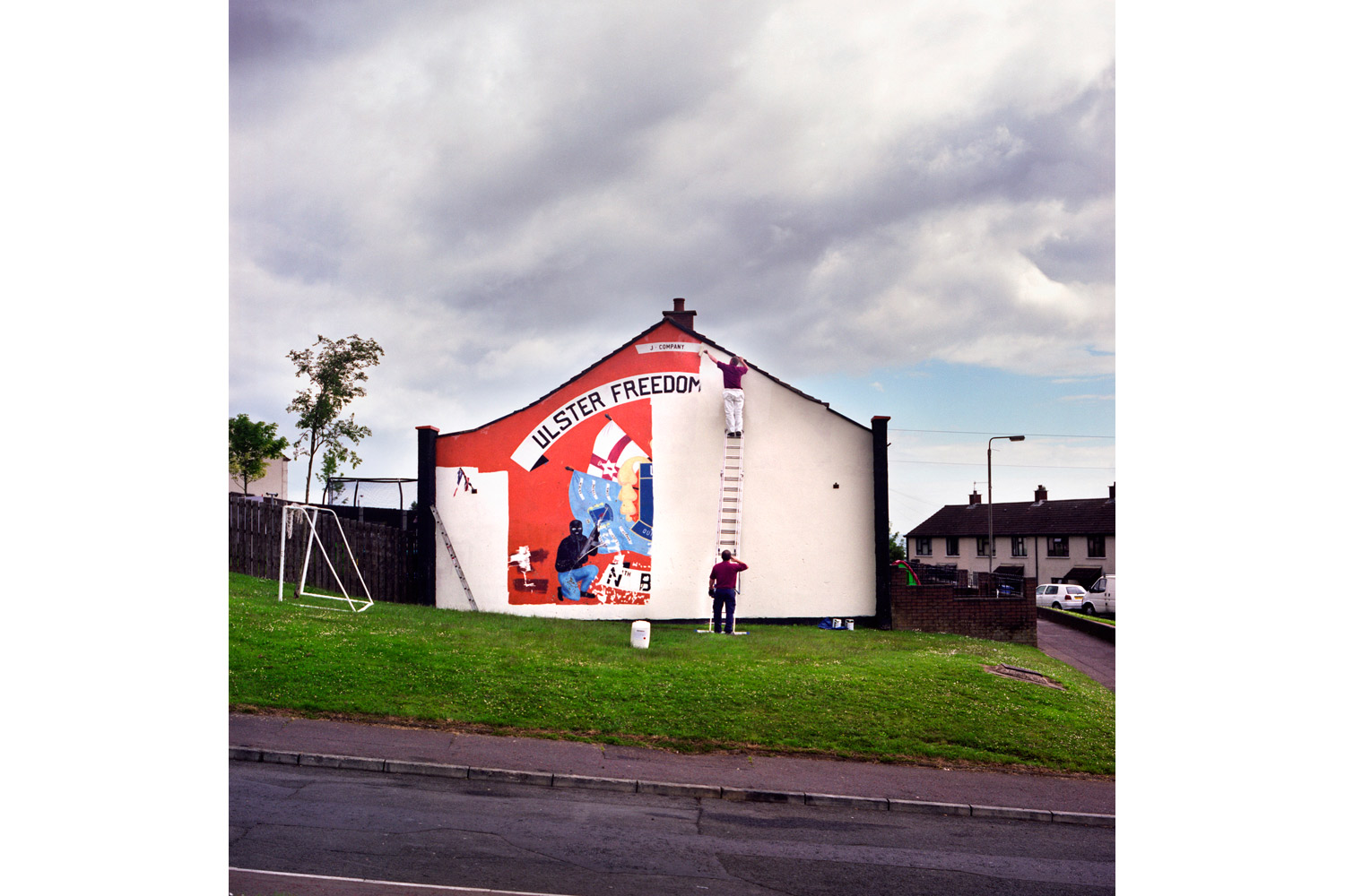 Photographs from the project Men and My Daddy                               The removal of the last loyalist UDA (Ulster Defense Association) paramilitary mural in North Belfast. As part of a larger revitalization effort, the UDA has committed to replacing traditional murals with more peaceful ones. 2010.