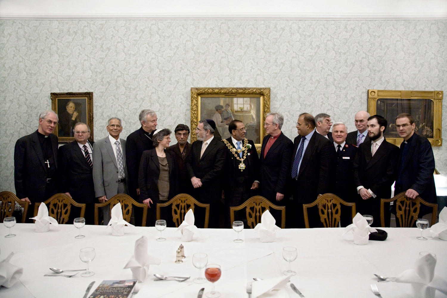Once a year, representatives of Birmingham's Buddhists, Christians, Jews, Jains, Muslims and Sikhs gather for dinner in Birmingham Town Hall. The quick and formal meal displays differing dietary requirements. 2007-2009.