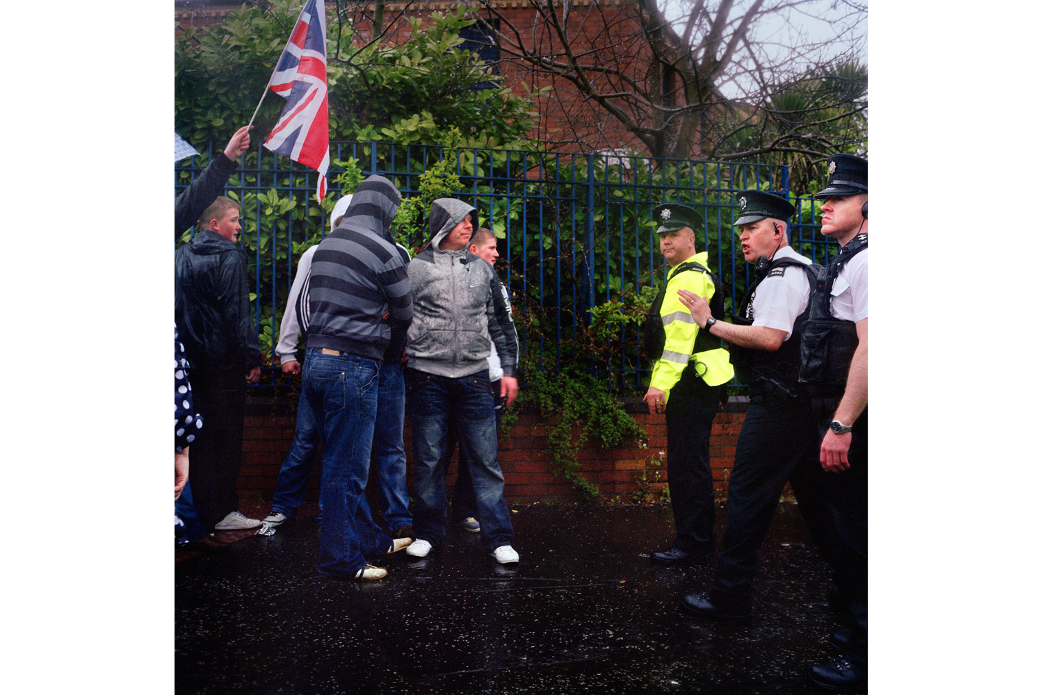 Members of the UVF clash with police at a protest against a Catholic parade. Unlike the UDA, the UVF has not yet engaged in the reimaging process and remains embroiled in allegations of violence, extortion and drugs. 2010.