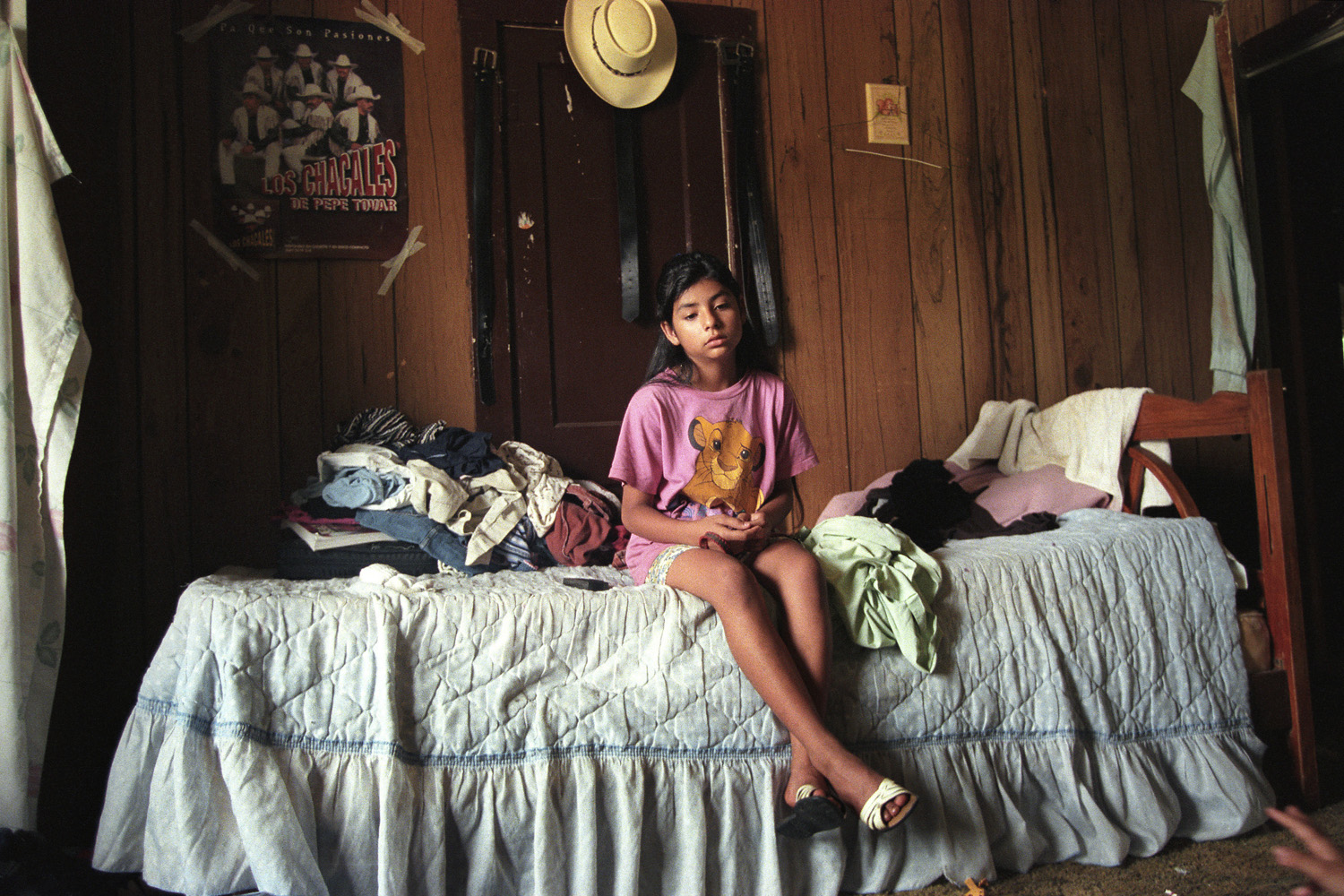 Texas, 2000. Marisol sits alone in her room, listening to the chaos of screaming parents and family members. Her family relocated to Texas soon after emigrating to Florida four years before. Tensions mounted between Marisol's parents and resulted in a bitter divorce that split her family in 2000.