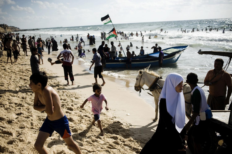Palestinians enjoy the Mediterranean Sea at a Hamas-run beach-side day resort in Gaza City, Palestinian Territories, July 28, 2010.