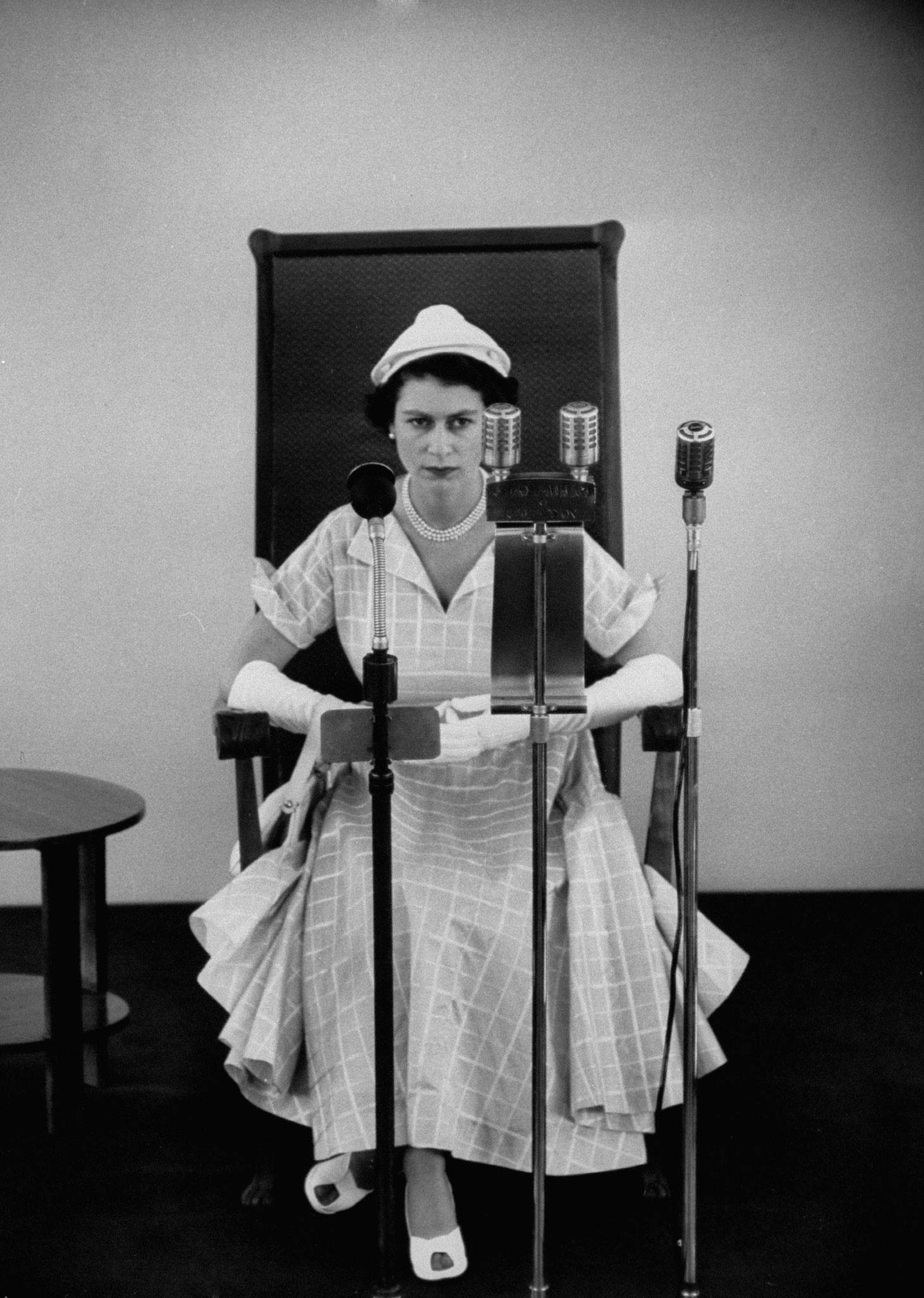 """Queen Elizabeth II (""""a little fagged after four days of royal touring,"""" as LIFE put it in its Dec. 7, 1953, issue) prepares to speak at University of the West Indies, Jamaica, 1953."""