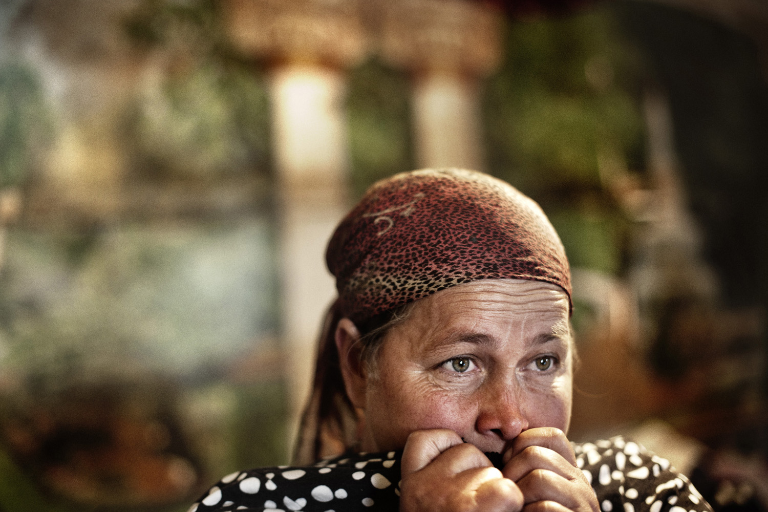 A Chechen refugee is frightened in 2009 during a Russian police visit to the refugee camp where she lives.