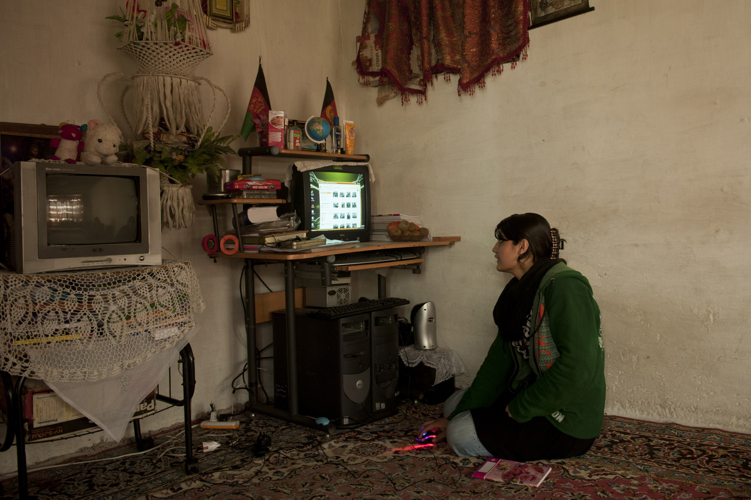 Rahimi plays a video game at her home in Kabul