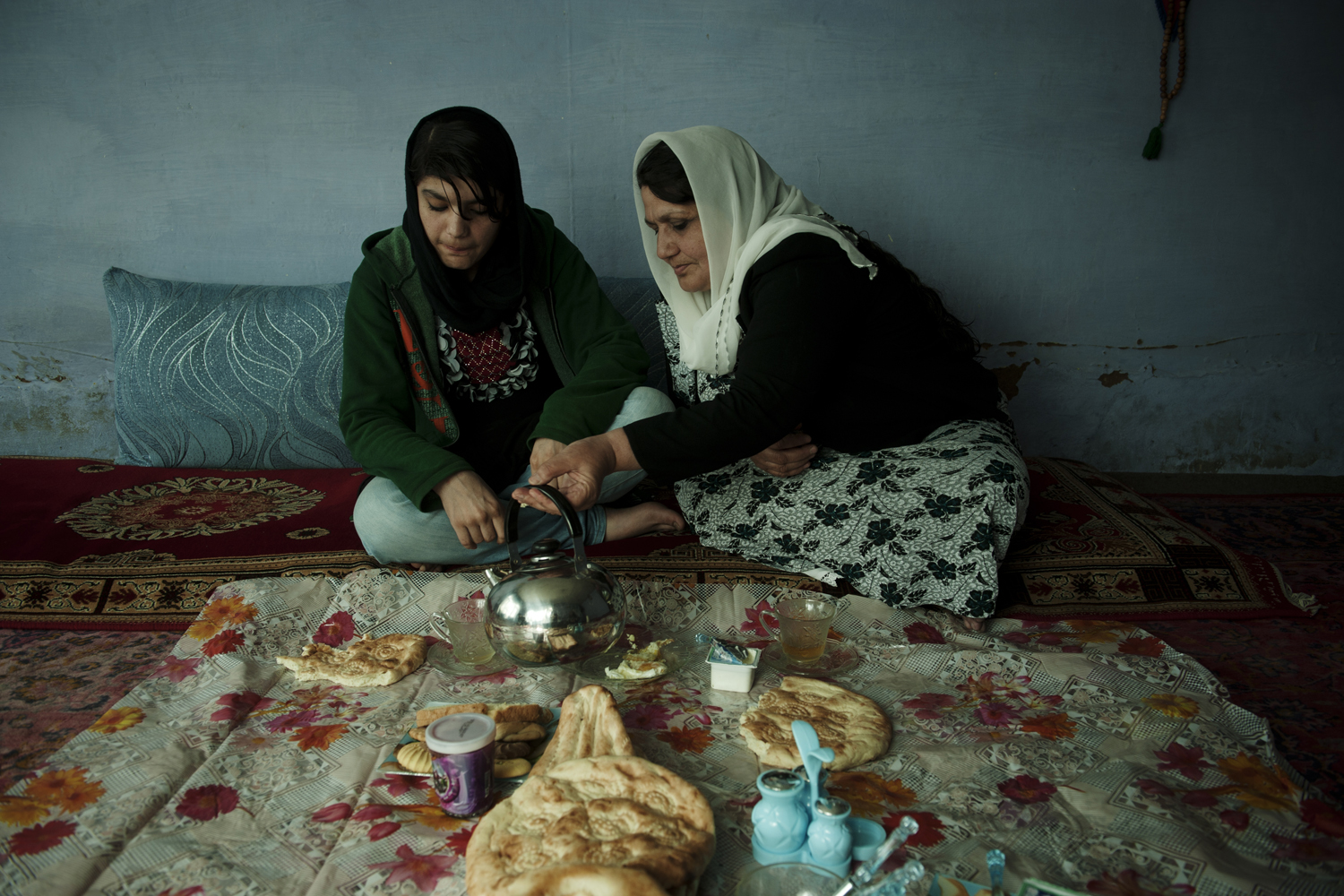 Rahimi has breakfast with her mother and sister at her family's Kabul home