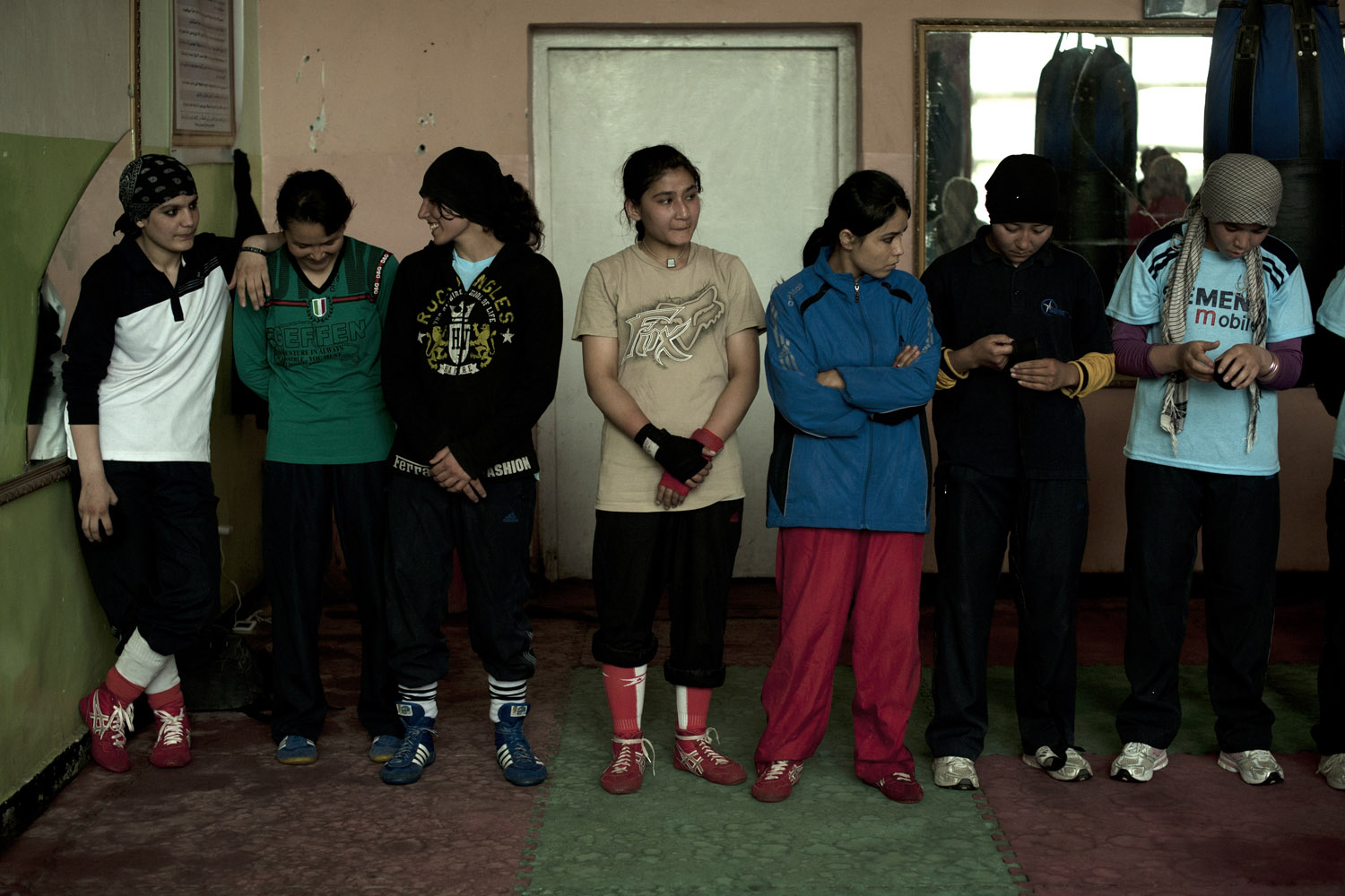 Rahimi, left, stands with other female boxers at the Olympic stadium in Kabul