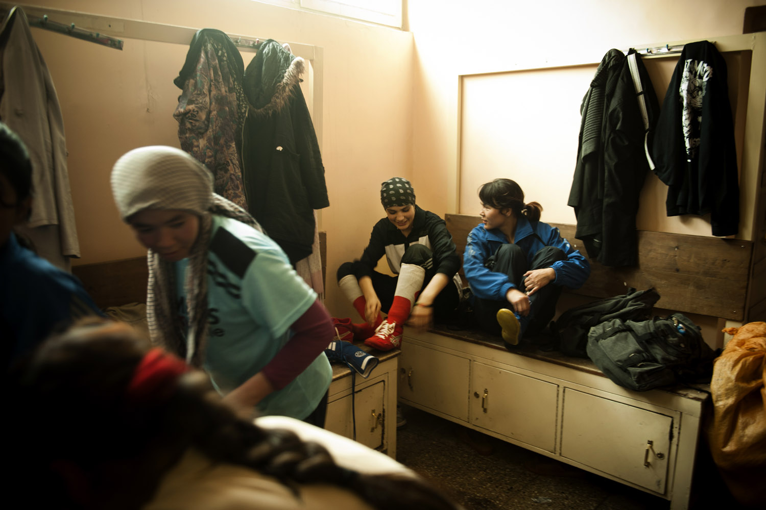 Rahimi rests with other female boxers after practice at the Olympic stadium in Kabul