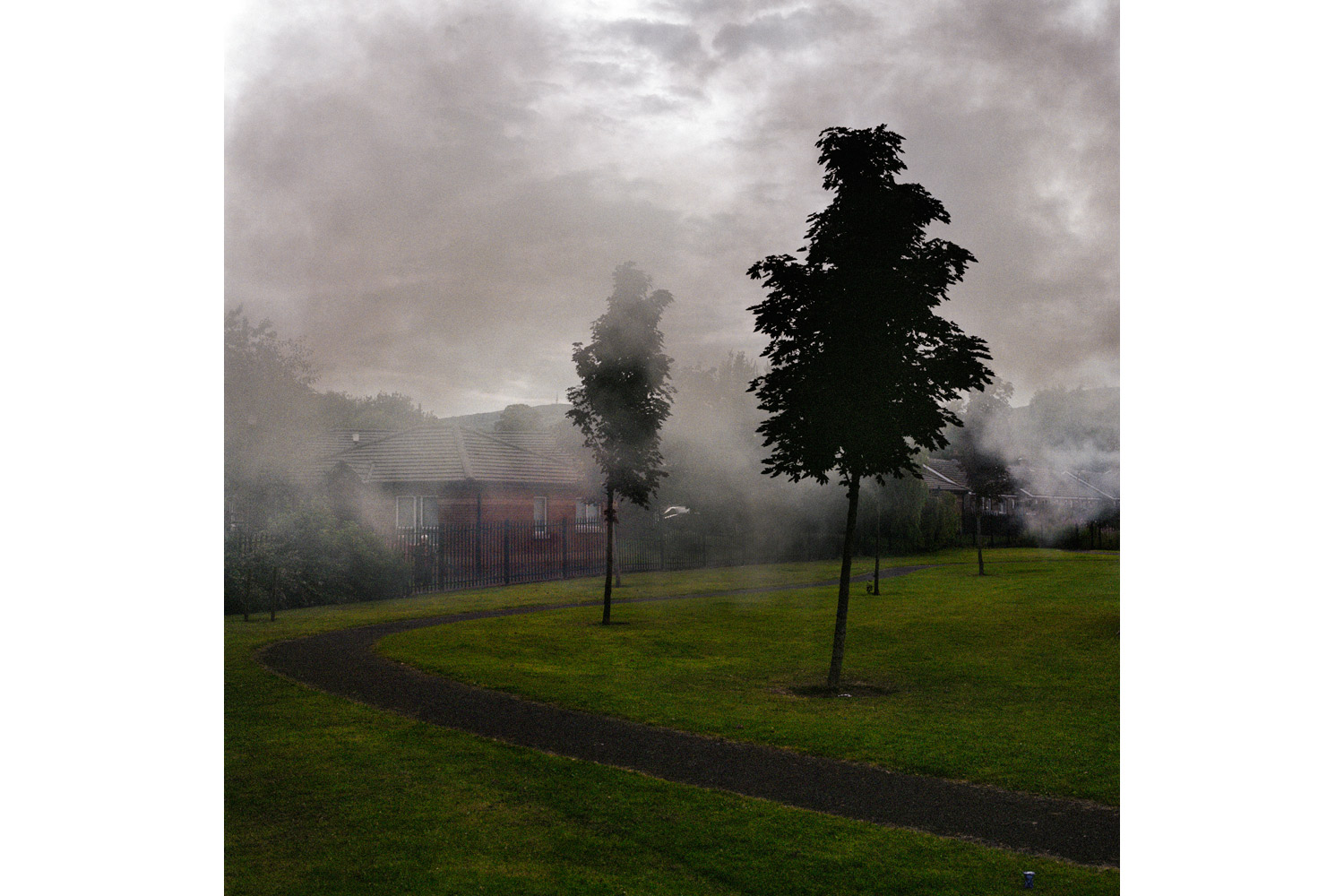 Smoke from a bonfire carries through Tigers Bay estate on July 11, 2011.
