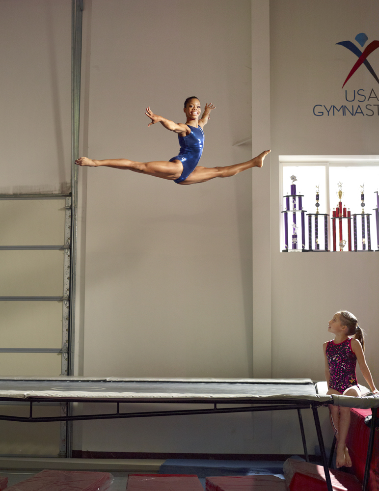Douglas trains at Chow's Gymnastics in Des Moines, Iowa.  while her host sister, also an up-and-coming gymnast, watches.
