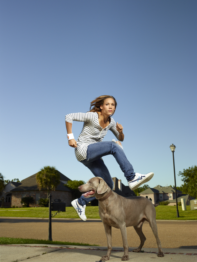 Jones jumps over her dog outside her home in Baton Rouge, La.