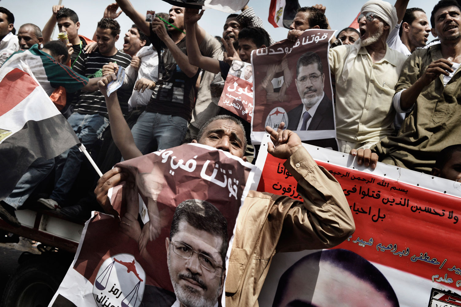 Supporters of Egypt's Muslim Brotherhood candidate Mohamed Morsy celebrate in Tahrir square after the Brotherhood claimed victory in the presidential vote. June 18, 2012.