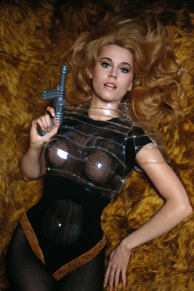 """Fonda poses in costume during the filming of Barbarella in 1967 in Rome.                                                              Barbarella rose to cult classic status in part because Fonda played it straight, Hurn said.                                                              """"And because she was very good in playing it straight, it allowed everybody else to be rather bad around her, you know. And I think most of the others around her were rather bad,"""" he said."""