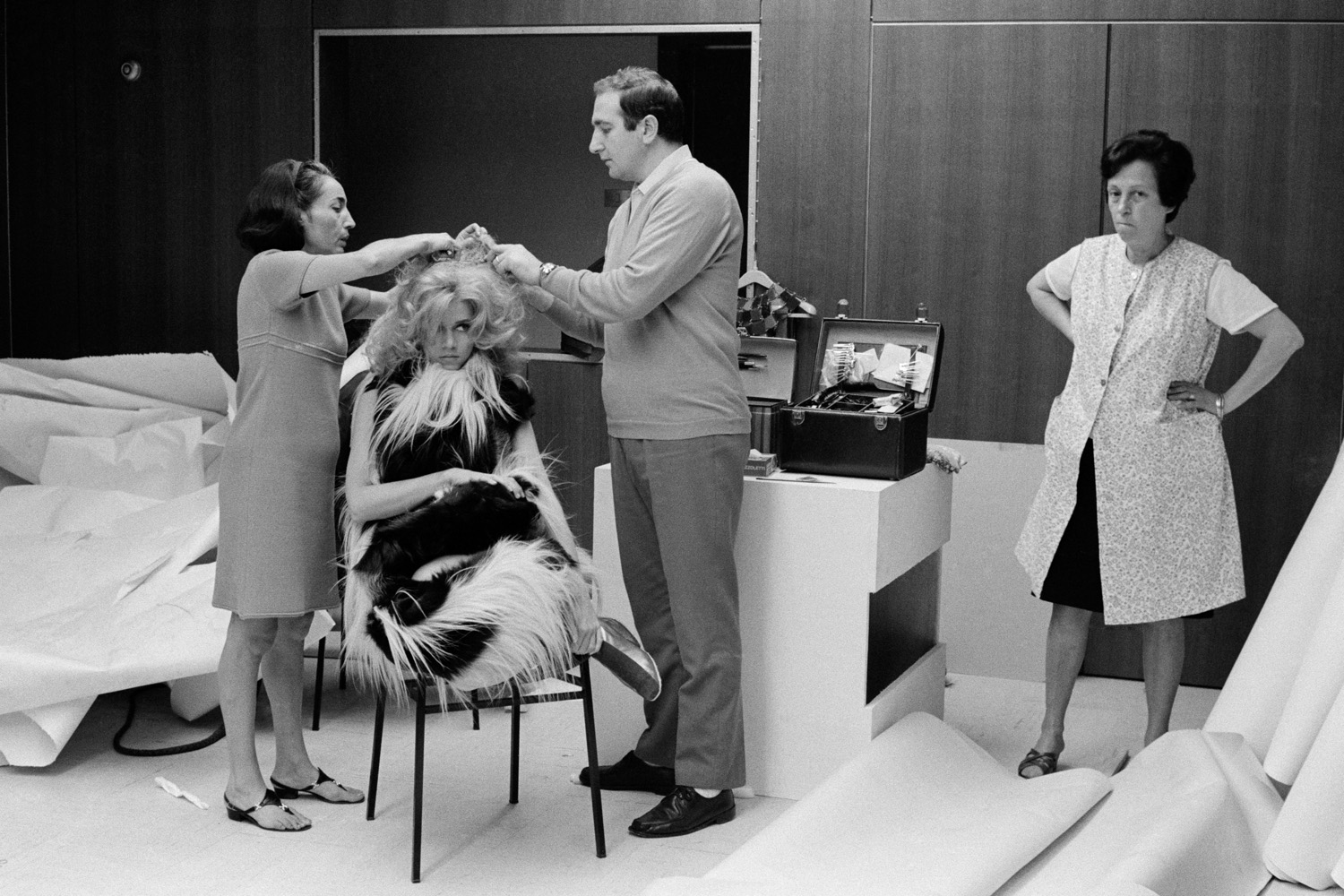 Fonda is helped into her costume while getting her hair fixed for the film Barbarella in 1967 in Rome.