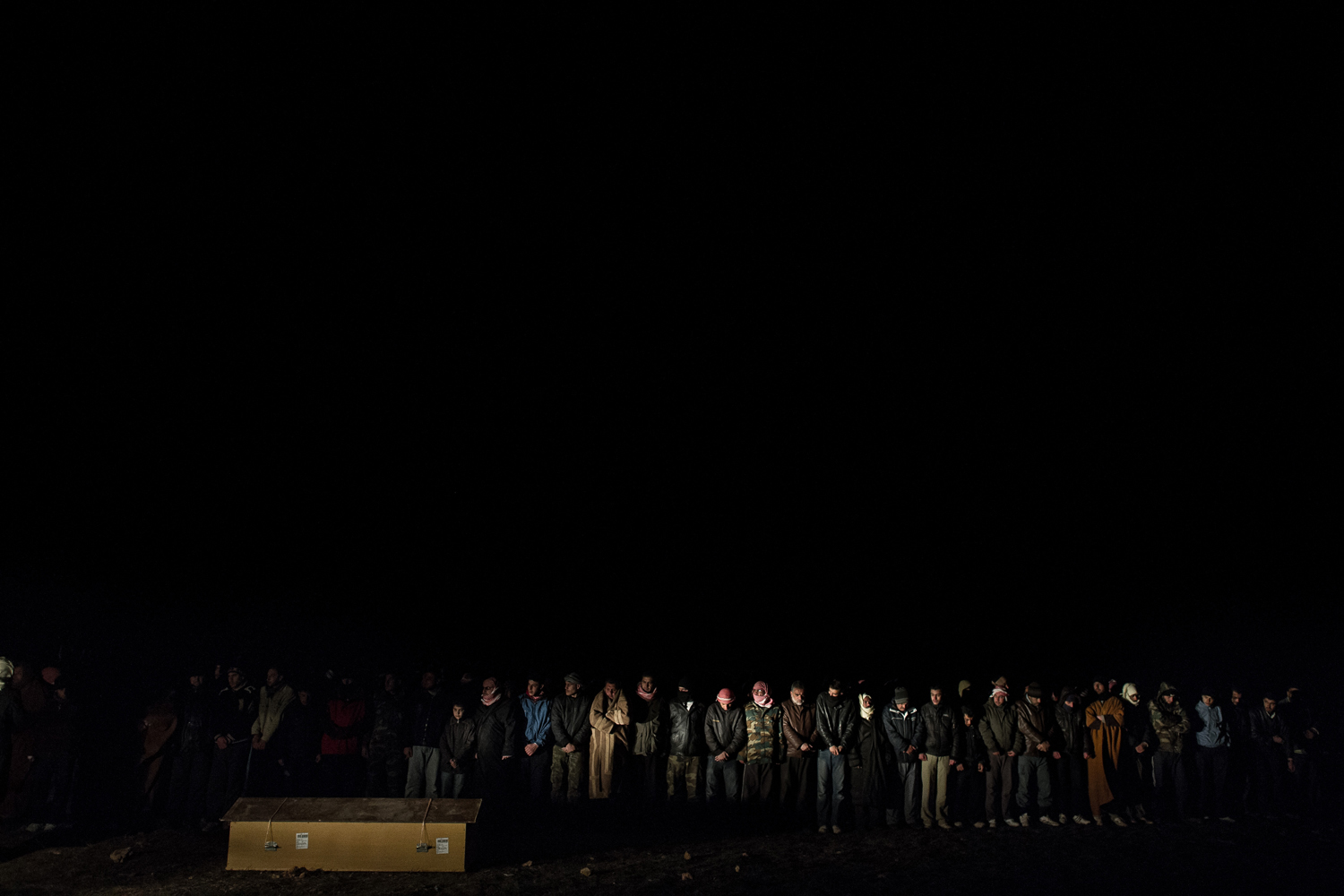 Rémi Ochlik                                                              Residents of Bouyada village pray at the 3 a.m. funeral of four young men who died after being crushed in their home during a shelling by Assad forces. Funerals often take place in the middle of the night to avoid attacks by the army.                                                               For those who knew Rémi well, it's strange to see that one of his very last pictures, if not the ultimate one, is of a funeral. You can't help but see a symbol in it. He took this photo of four slain people stuck in the same coffin, and a few hours later he himself was killed by a shell. He didn't even get a coffin; it took days to recover his body amid the intense fighting in Homs.                                                              Rémi had something very serious and thorough about the way he took his pictures. He'd been wanting to get into Syria for months. When he finally got inside, near the town of Zabadani, it was simply too dangerous to make any good images. He managed to squeeze out through the border, back into Lebanon. And then straight away, he wanted to go back, to make stronger images. He crossed into the al-Qusayr area, where he took this last photo. A few hours later, he got into Homs in the black of night. He wrote us an e-mail to describe how incredibly tense and confused it was in the besieged Bab Amr neighborhood. The e-mail was bleak, but he concluded, 'I plan to start taking photos first thing tomorrow morning.' That never happened.  —Alfred de Montesquiou, senior correspondent for Paris Match