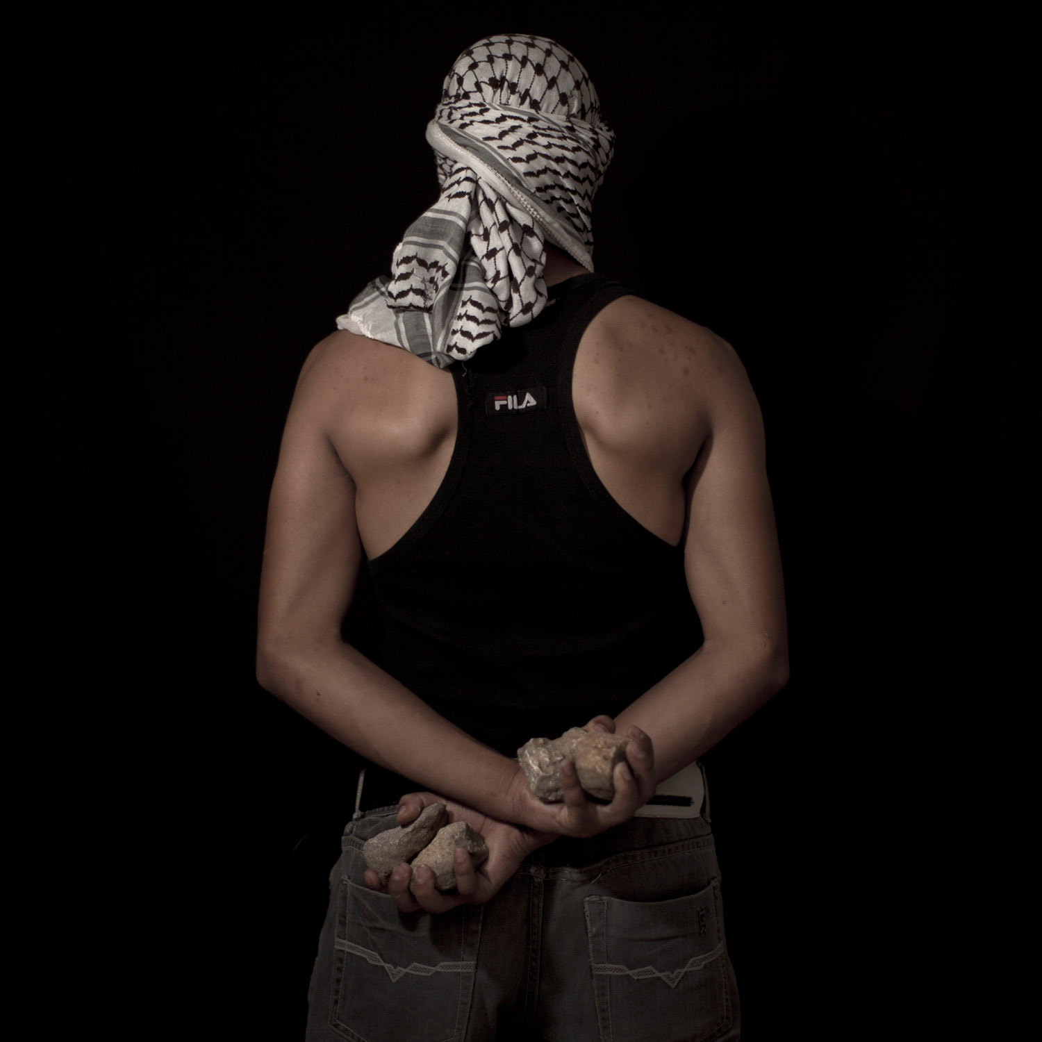 Portrait of a Palestinian stone thrower in the West Bank village of Bilin, near Ramallah. June 13, 2012.