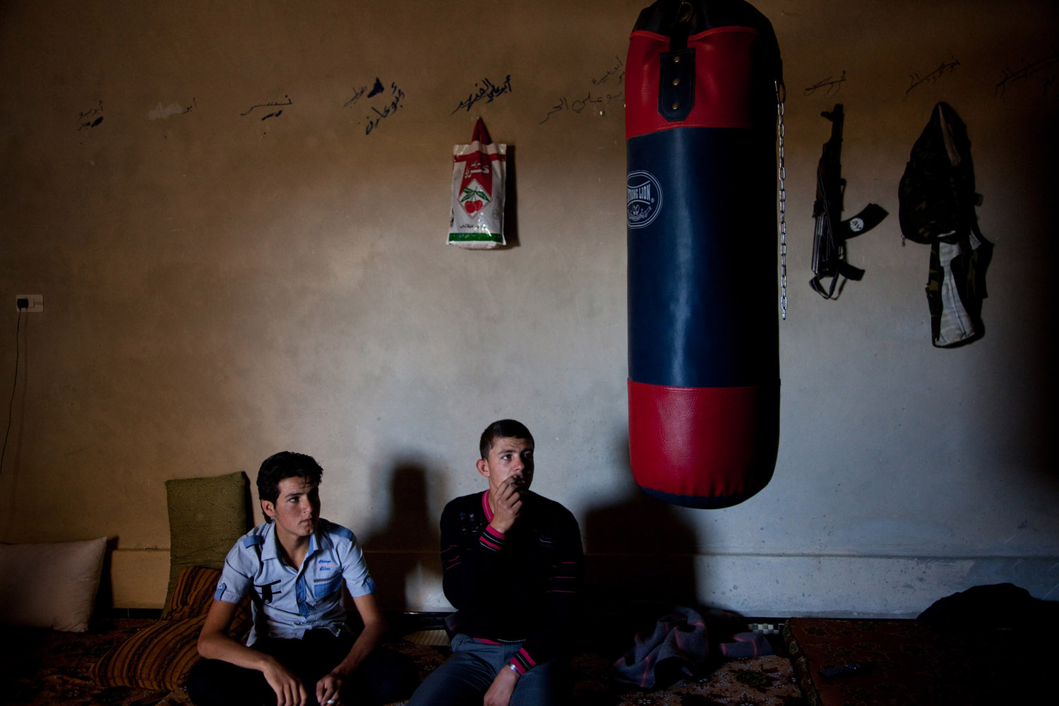 Free Syrian Army fighters sit inside a room at their base in Mara'a on June 8, 2012. The opposition are hoping for Aleppo to fall to FSA hands but fear that the fighting could be tougher than Homs in February.