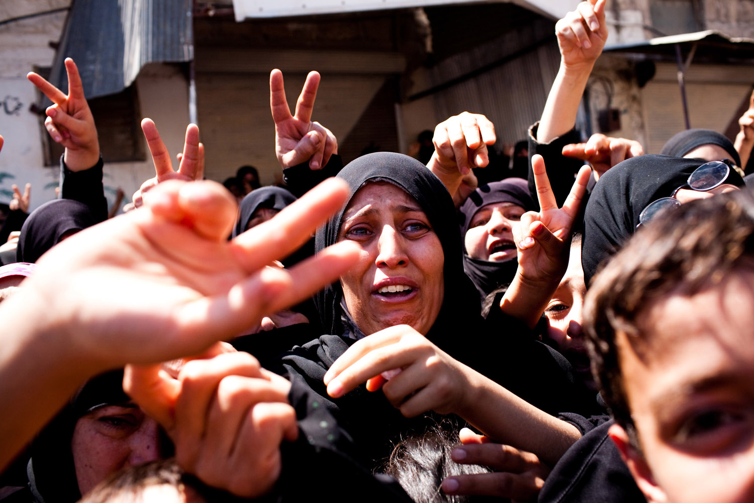 Women, including the mothers and sisters of those killed, cry during demonstrations that took place after many civilians were killed the night before by mortars fired on the city of Maarat Al Noman by the Syrian Army on June 10, 2012.