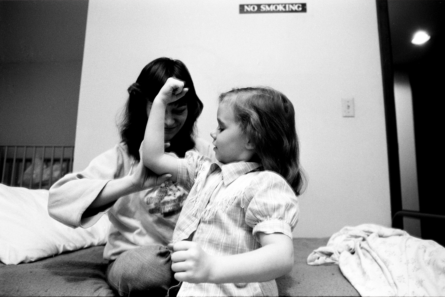 Mary's daughter shows her the strong woman she will grow up to be. Minneapolis, 1986.