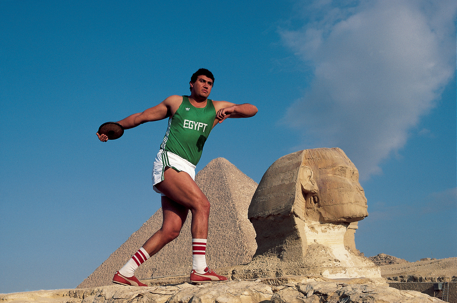 Mohamed Naguib Hamed poses with discus in front of the Pyramid of Khufu and the Great Sphinx in Giza, Egypt.