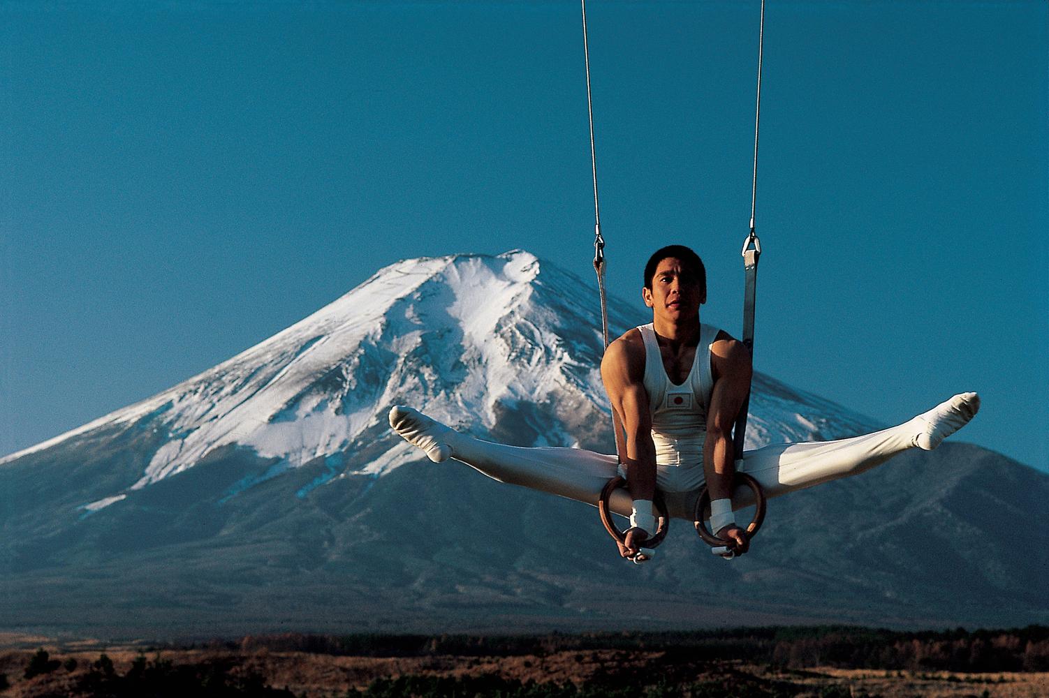 Koji Gushiken on rings in front of Mount Fuji, Japan.