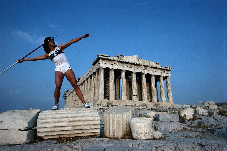 Sophia Sakorafa poses with javelin in front of The Parthenon at The Acropolis in Athens.