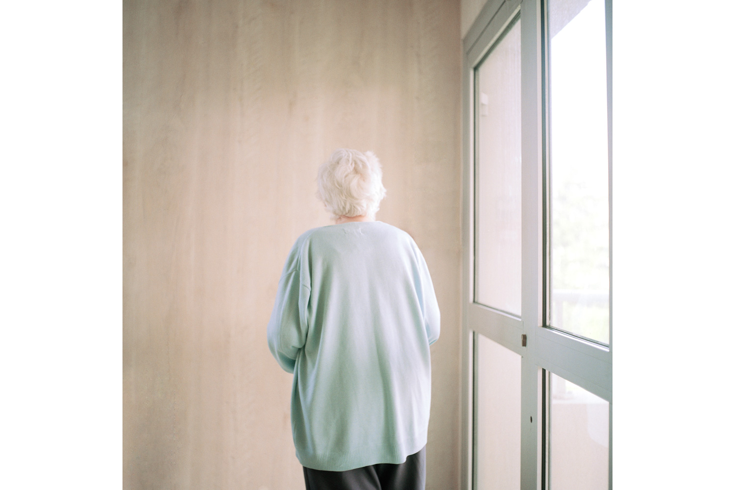 A resident stops in front of a wall in the Alzheimer's ward. A common symptom for Alzheimer's disease is sudden immobilization or fixation