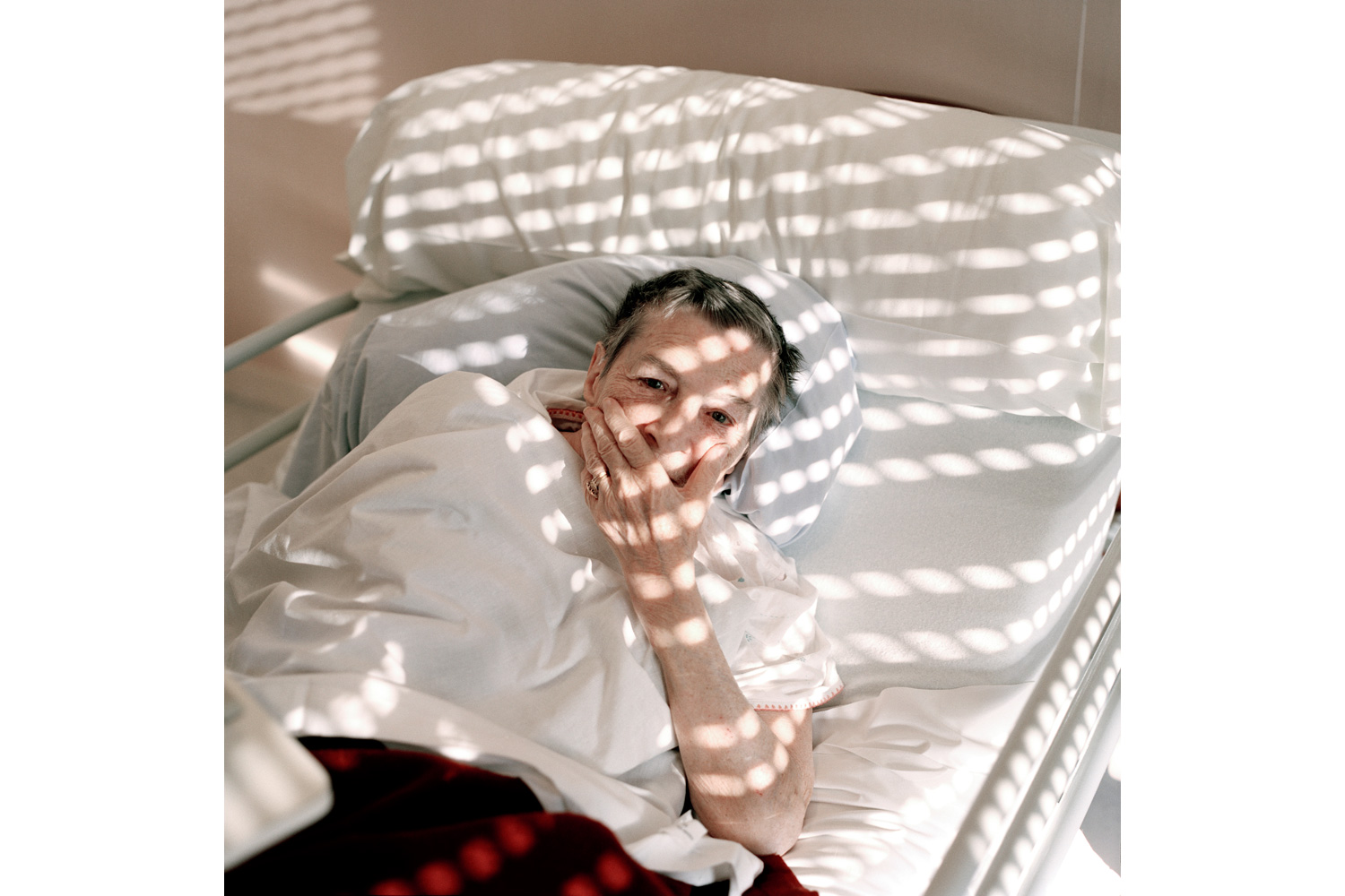 A resident lies in bed in the Alzheimer's ward. Most residents in the ward have reached a state in which they have lost most of their communication skills and few even recognize family members