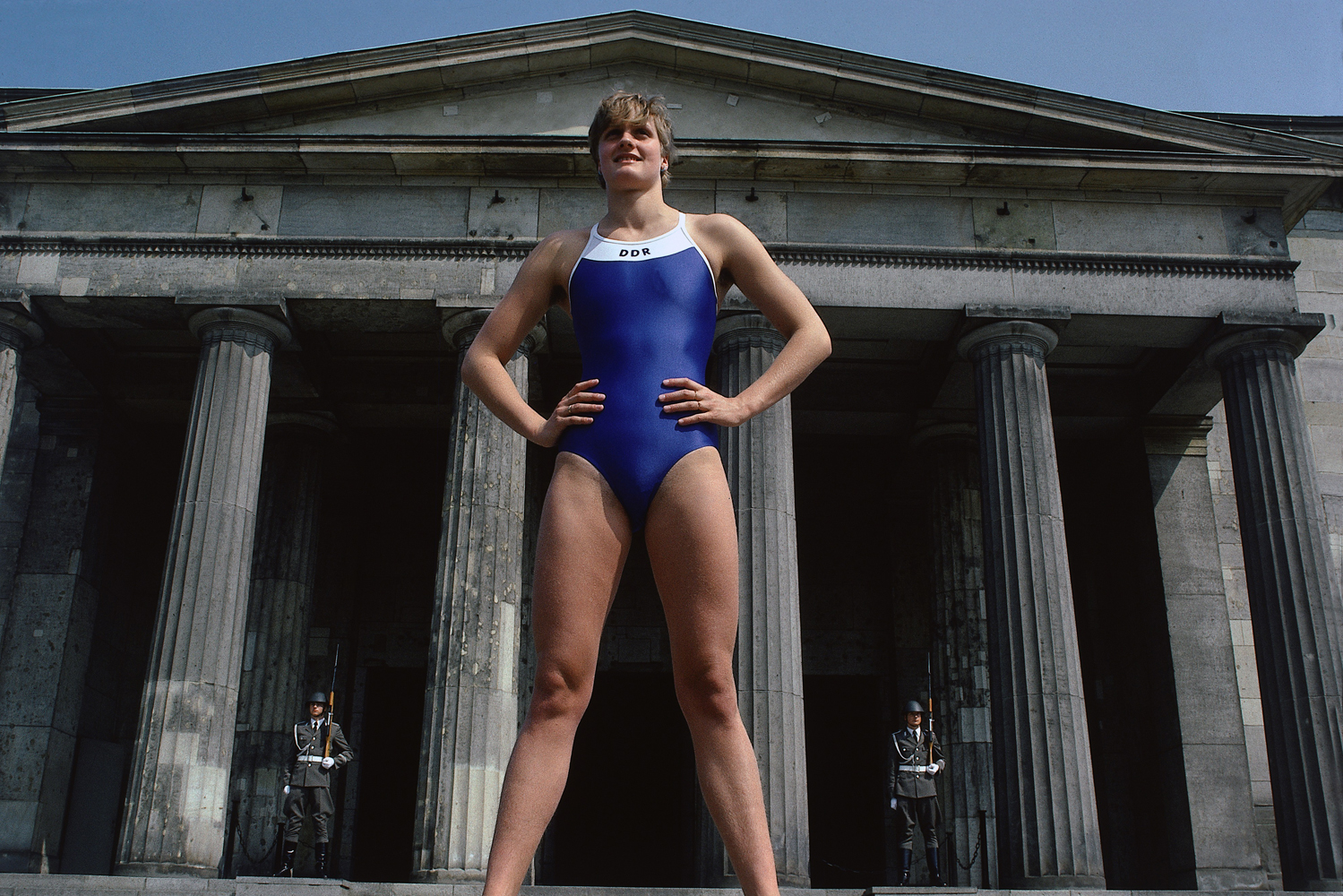 Kristin Otto poses in front of the Tomb of the Unknown Soldier in East Berlin.