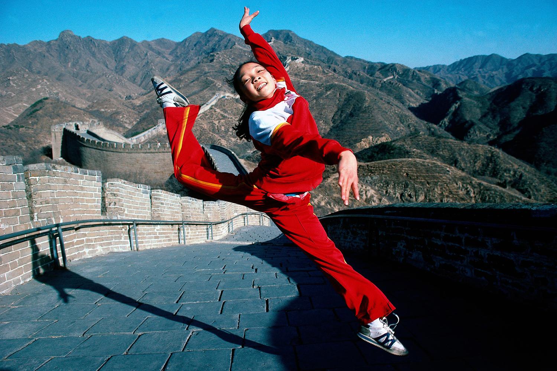 Gymnast Zhou Qiurui on the Great Wall of China. Shanhaiguan, China.