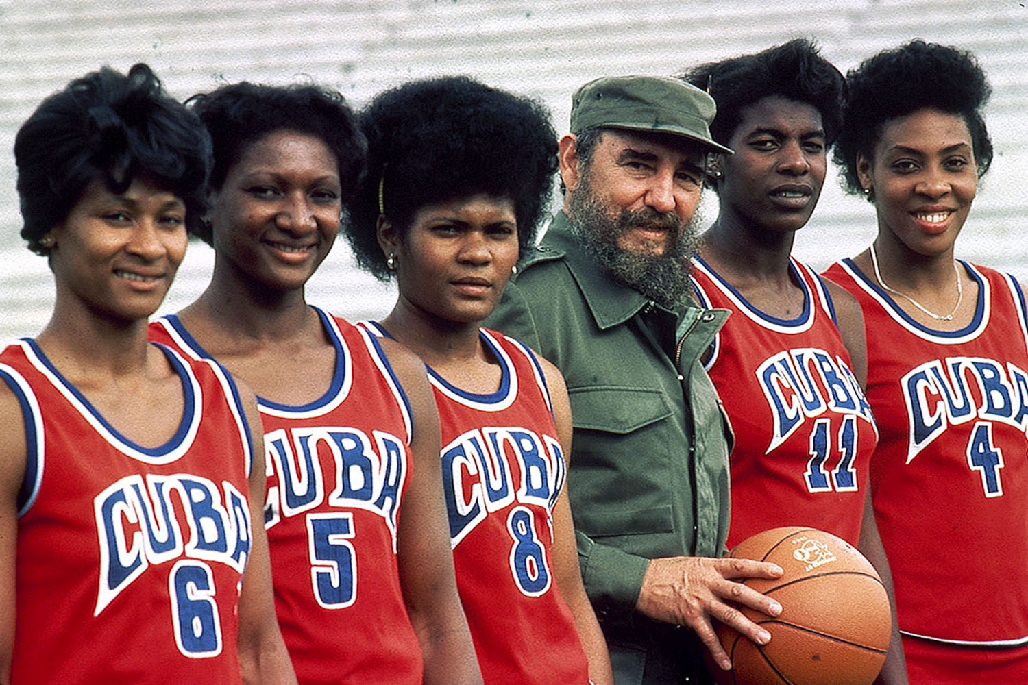 Fidel Castro poses with the Cuban women's basketball team in Havana.