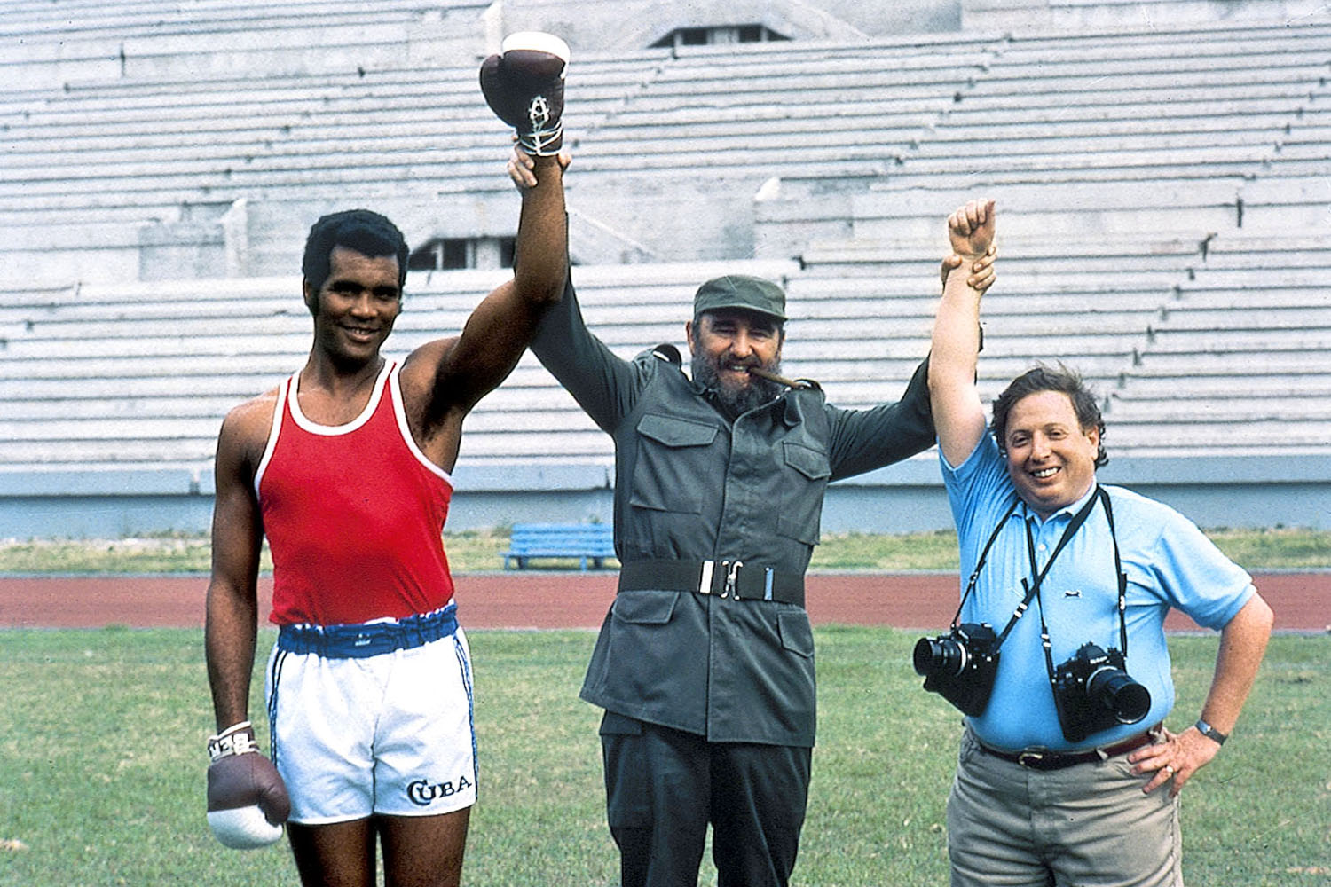 Photographer Neil Leifer (right) poses with Fidel Castro and Cuban heavyweight boxer Teofilo Stevenson while on assignment in Havana.