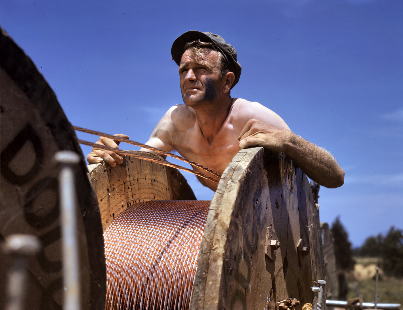 June 1942.  This husky member of a construction crew building a 33,000 volt power line into Fort Knox is performing an important war service. Thousands of soldiers are in training there, and the new line from a hydroelectric plant at Louisville is needed to supplement the existing power supply.