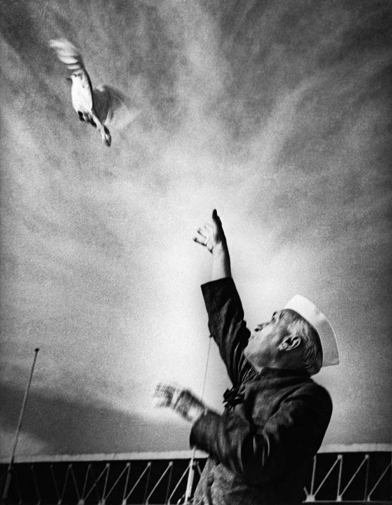 Nehru releasing a dove as a sign of peace at a public function at the National Stadium in new Delhi, mid 1950's