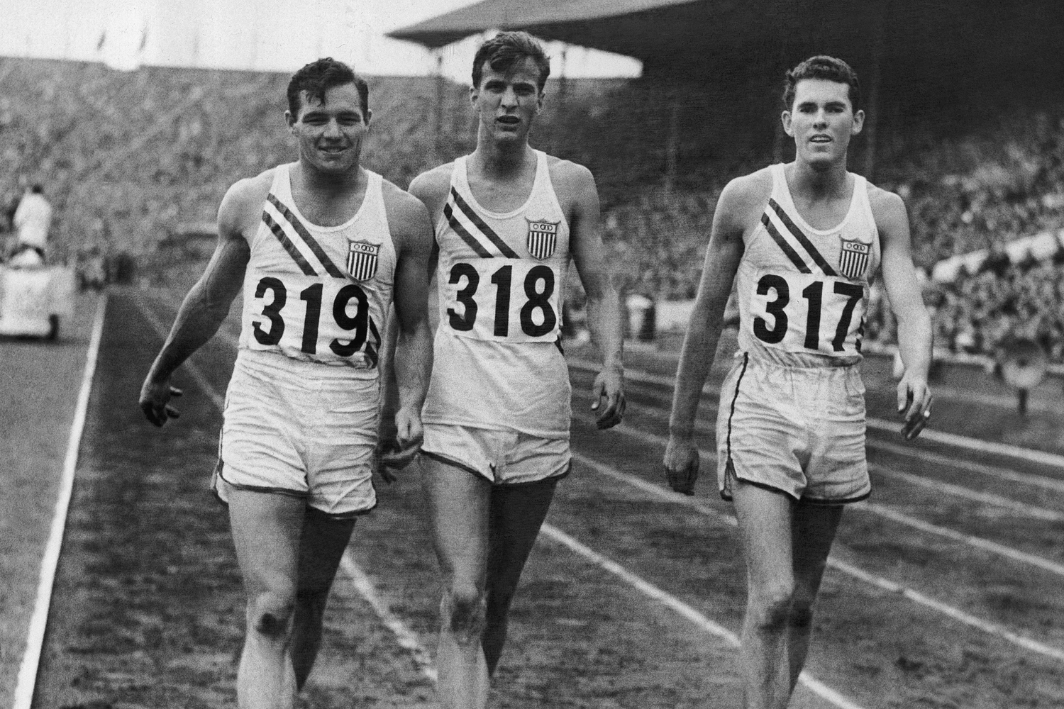 Craig Dixon (right) with two teammates at the 1948 Olympic games.