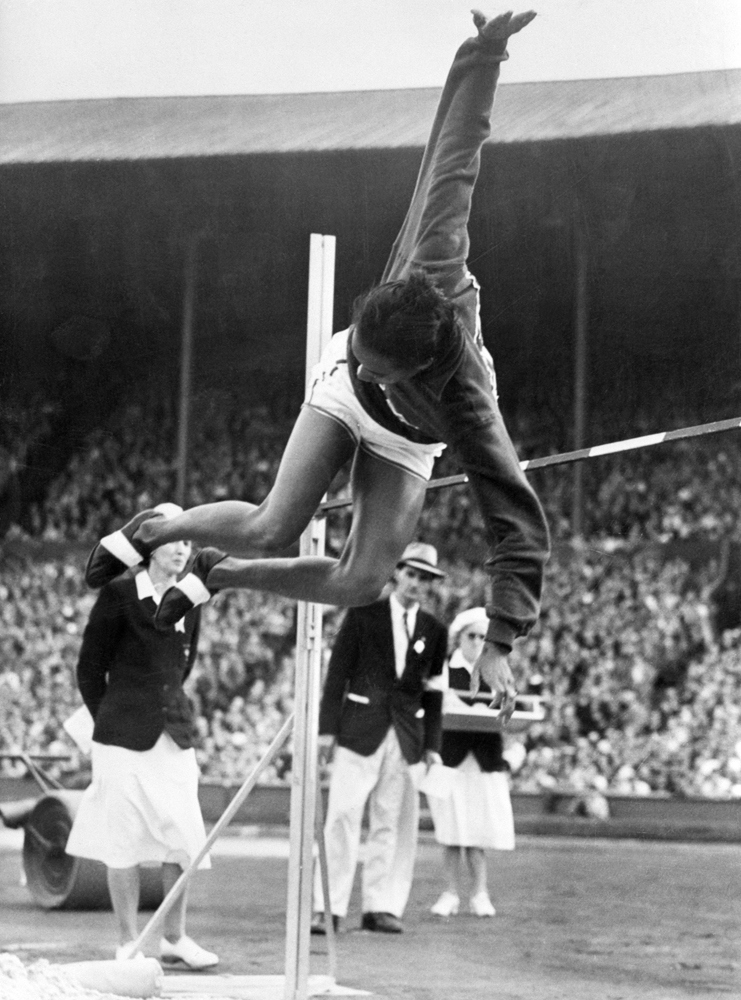 Alice Coachman, a high jumper from Albany, Ga., clears the bar with an Olympic-record-breaking leap in 1948.