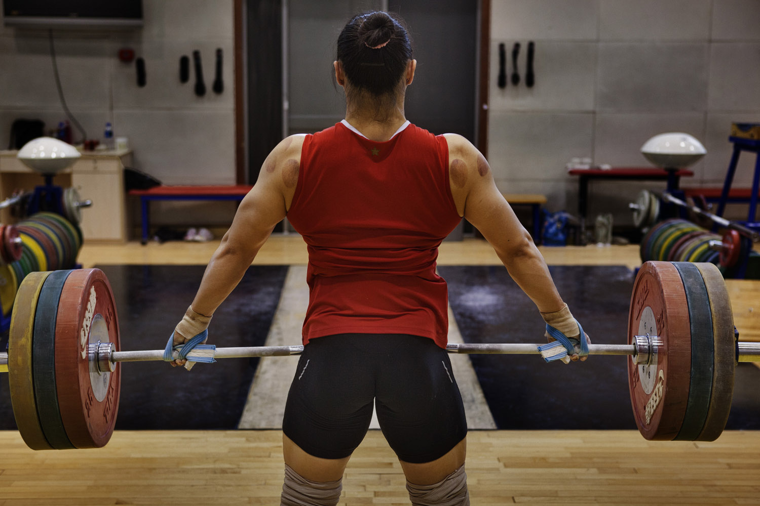 Kang Yue is seen training for the Chinese national women's weight-lifting team in May 2012 at the national sports training center in Beijing. The 30 athletes who make up the team were competing for spots on the Olympic squad, for which Yue did not qualify.