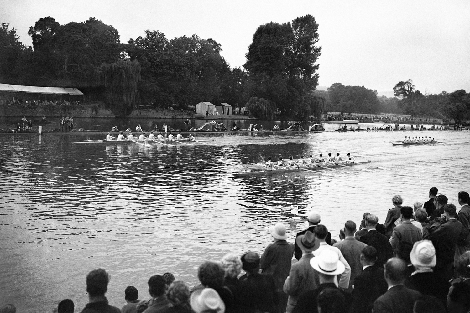 Great Britian's boat, in the foreground, winning the first heat of the eights from Norway and Denmark at Henley during the 1948 Olympics.