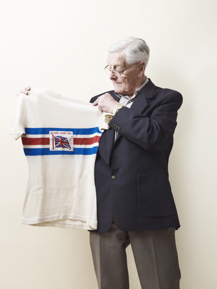 Thomas Godwin, a 91-year-old British cyclist who took home two bronze medals in the 1948 London games, holds his Olympic jersey.