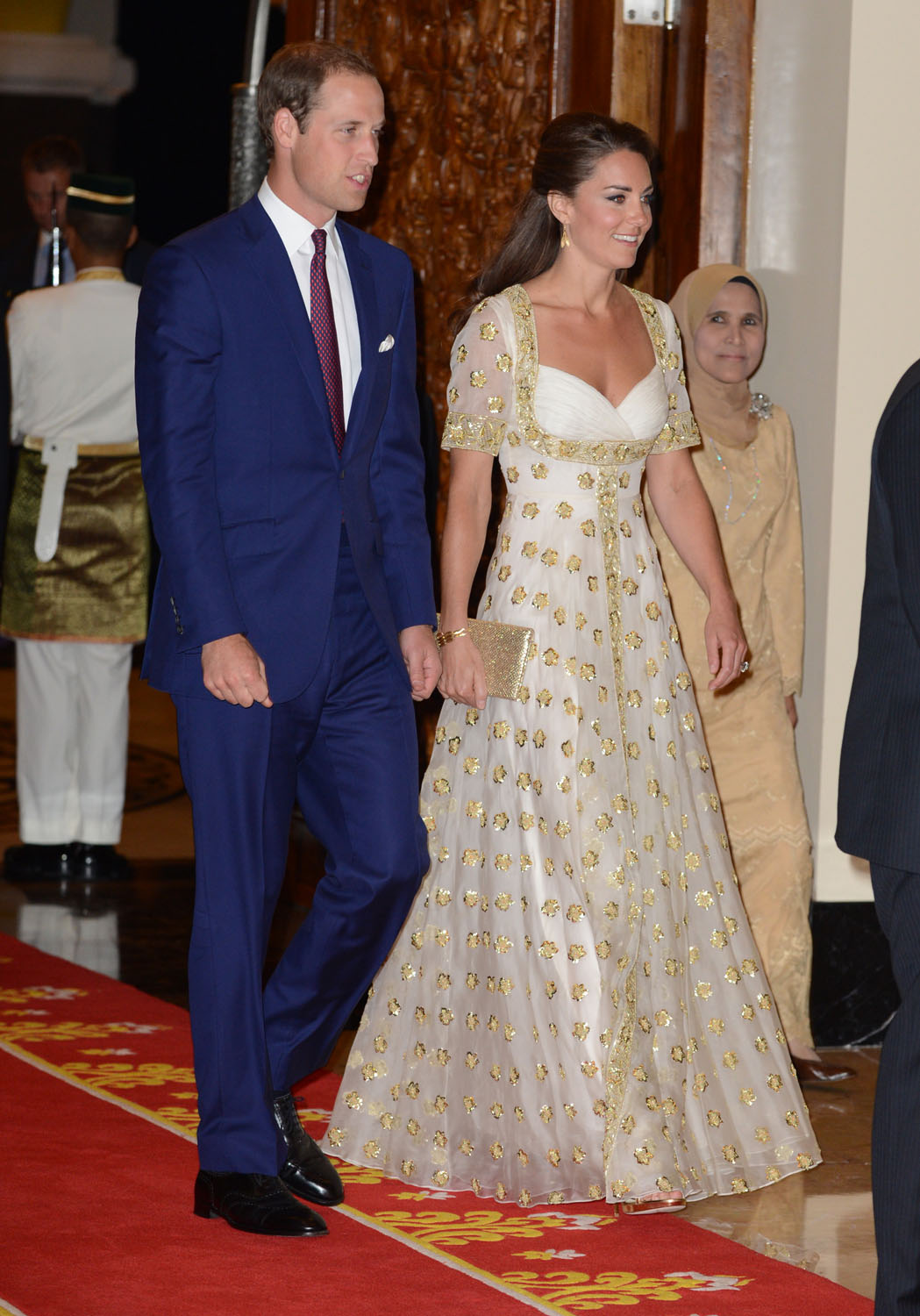 <strong>White and Gold</strong>Prince William, Duke of Cambridge and Catherine, Duchess of Cambridge attend an official dinner hosted by Malaysia's Head of State Sultan Abdul Halim Mu'adzam Shah of Kedah on September 13, 2012 in Kuala Lumpur, Malaysia.