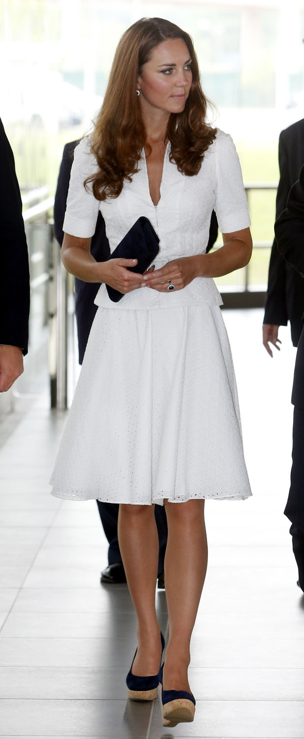 <strong>The White McQueen</strong>Catherine, Duchess of Cambridge tours the Rolls-Royce Seletar Campus during the Diamond Jubilee tour at Seletar Aerospace Park on September 12, 2012 in Singapore.