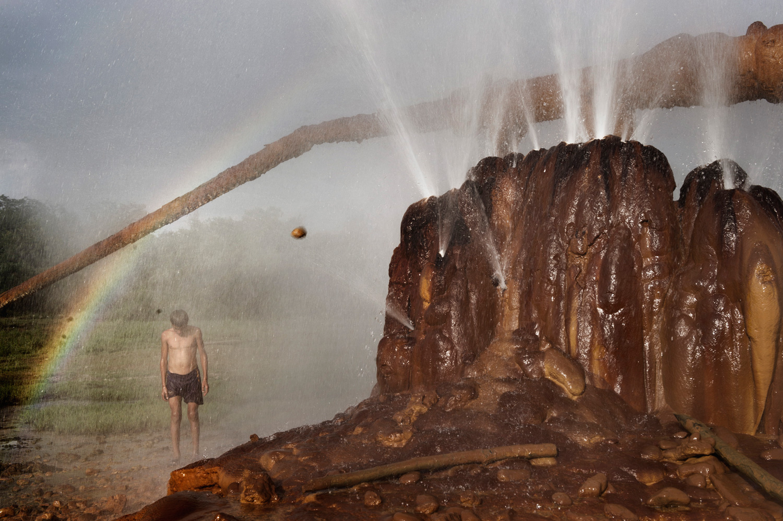 Abkhaz boys play in a hot spring in Ochamchira.