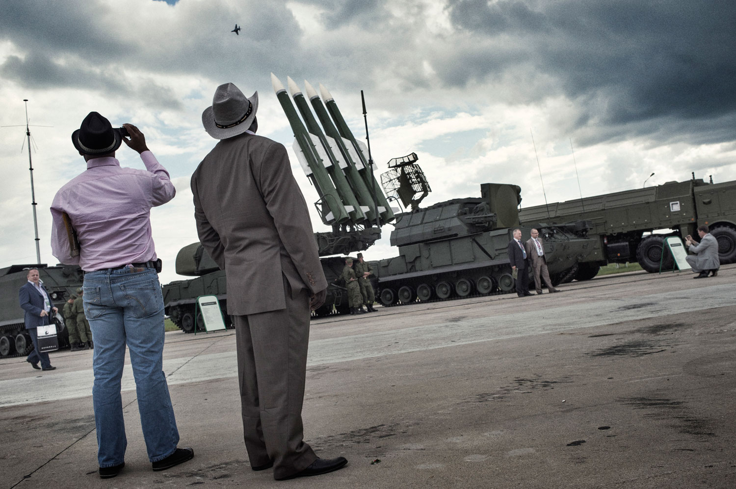 African delegates to the arms bazaar study the SA-17 Grizzly anti-aircraft missiles and other Russian heavy artillery.