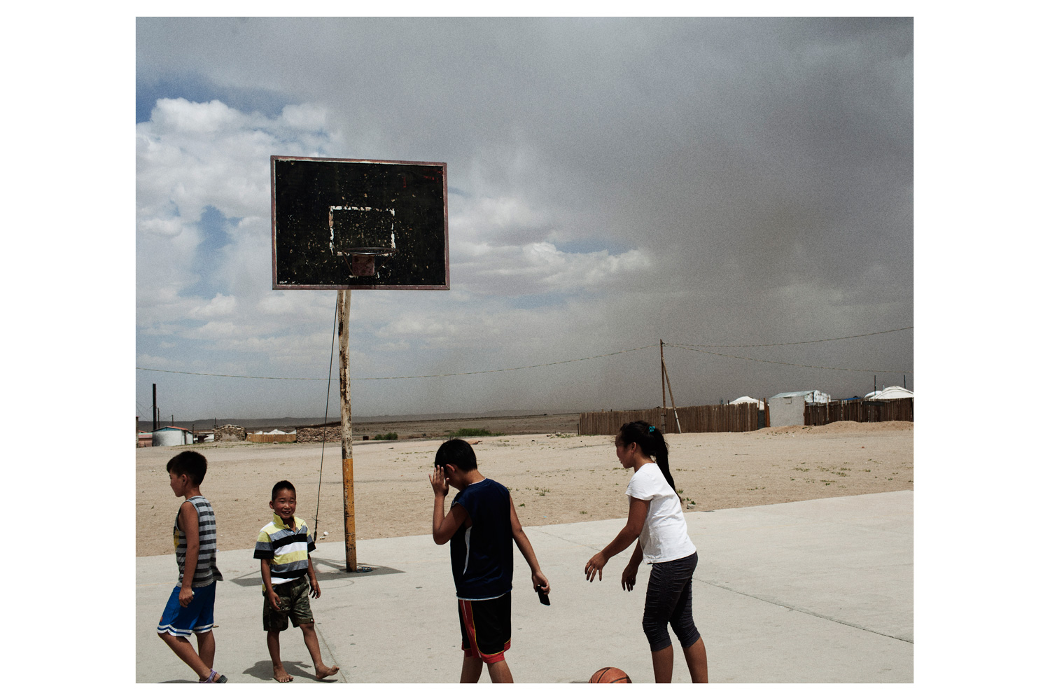 Children play in the area in the Gobi desert where 88 nomad families have been affected by the construction of the mine.