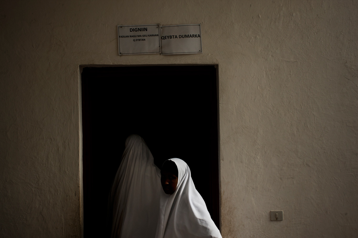 The following photos were taken in June 2012 Women enter a hospital in Mogadishu, which has become more active since Al-Shabaab was pushed out of the city.