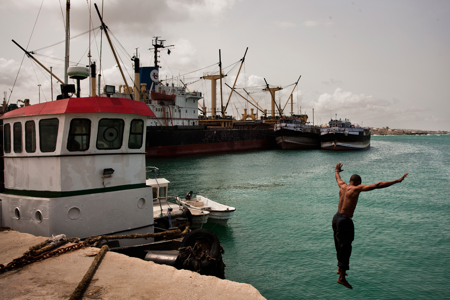 A Somali man jumps into the water at the port in Mogadishu.