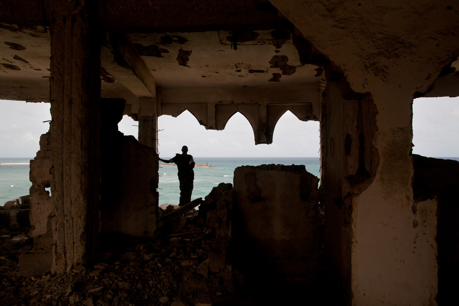 An African Union soldier stands on the top floor of the destroyed Al-Uruba hotel.