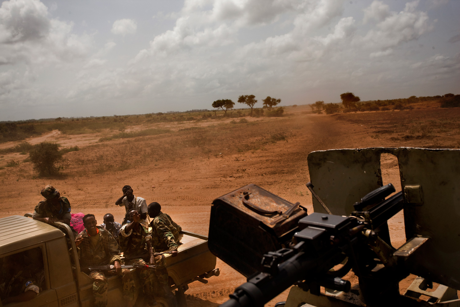 Transitional Federal Government forces drive past an AU convoy along the Afgoye-Mogadishu corridor.