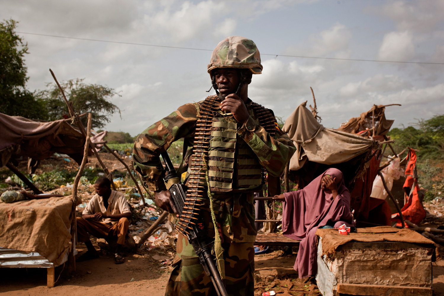 An African Union soldier in the Afgoye market where Somalis sell goods, including khat, which was previously banned under Al-Shabaab.